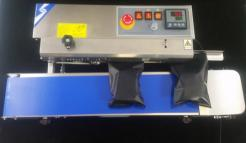 Continuous Band Sealer with Products