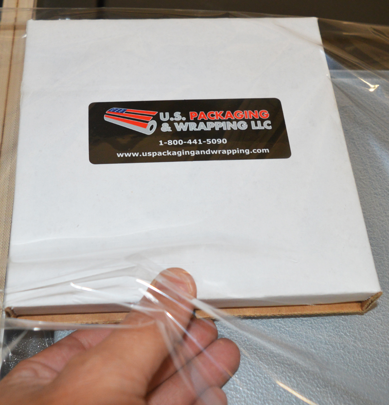 98a369037a4 Insert product into shrink wrap material